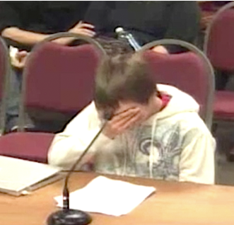 Bullied student breaks down testifying before the school board members who had created the offensive policy.  Photo: Screen shot from trailer.