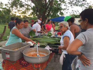 Diners at a weekly dinner and workshop in Vieques after hurricane Maria